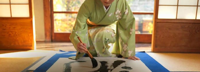 woman painting caligraphy