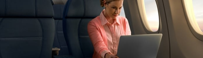Woman sitting in First Class