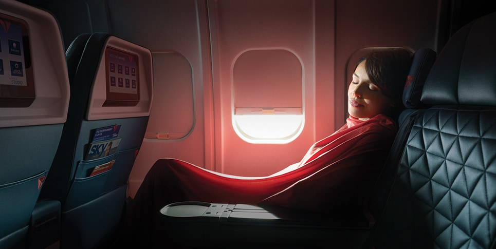 Woman sleeping in first class