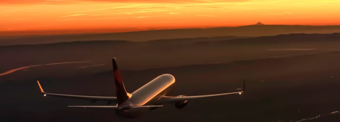 Plane flying toward horizon