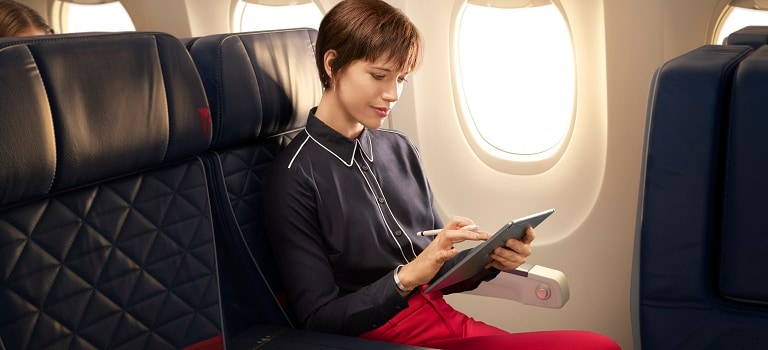 Customer watching tablet on plane